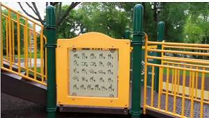 childrens playground with sign showing sign language