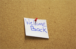 a bulletin board with a note that reads 'welcome back'